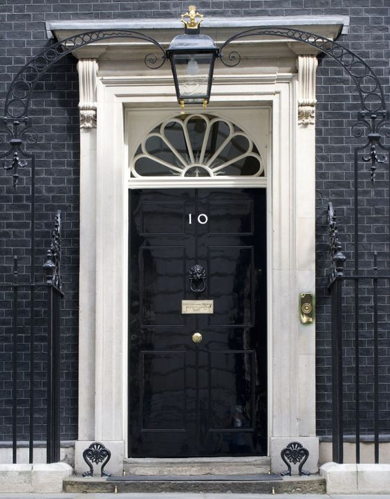 black door 10 downing street london come in looking