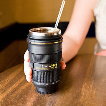 I am always buying gifts for my photographer friends. This one wins...Hands down. Canon and Nikon Lens mugs and thermoses. HOT!