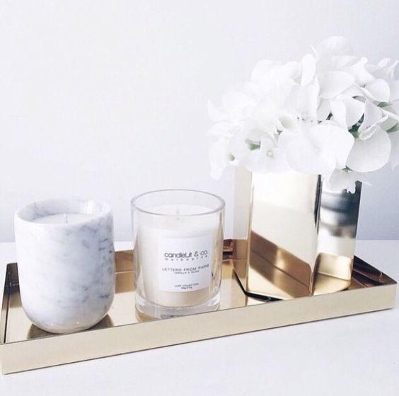 I want decor pieces also to give a finished look to the room. I like the granite candle and sparkly trays.