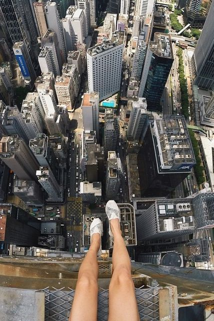 The trend, called Rooftopping, has thousands of photographers climbing to the top of the world's tallest skyscrapers for an unrestricted, bird's-eye view of the street below.: