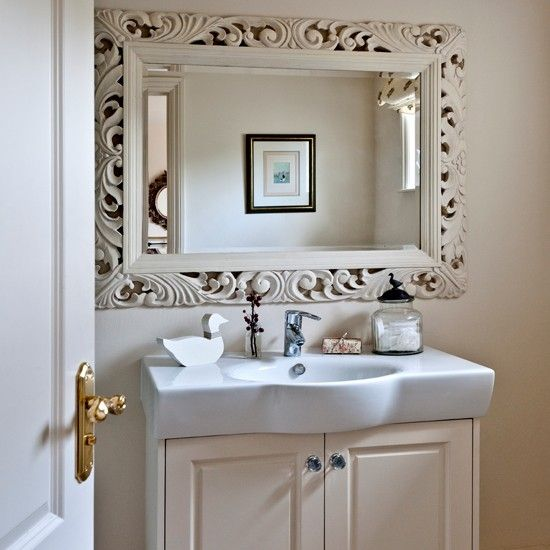 neutral bathroom with dramatic mirror country decorating