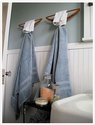 Cute, creative, and cheap. One could play with a variety of colored clothes hangers or towels to match. Turn a clothes hanger upside down and use it as a towel rack and hook.
