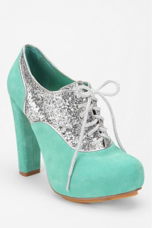 Weird combination between a tennis shoe and a high heel i'm not sure if i like that or not hmmm............