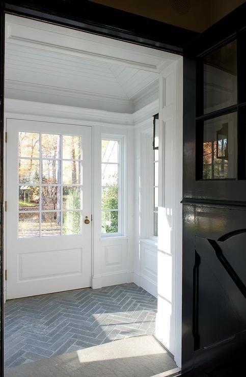 Mudroom with slate herringbone tiled floors | Brooks & Falotico