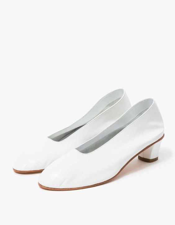 Elegant, handmade slip-on small heel from Martiniano in White. Features rounded toe, supple leather uppers, high instep, lined cuff and matching leather heel with rubber heel cap.   •	Handmade slip on leather shoe in White •	Rounded toe •	Lined cuff