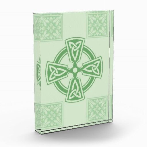 Celtic Cross Design  Celtic crosses are an eternally popular form of Celtic art & design. This example also features a replica of floral medieval tiles, based on a stone carving in a cathedral. Displayed in a beautiful acrylic cube which is perfect in a sunny window or bookshelf display.