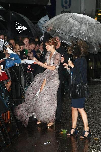 Emma Watson, chic in the rain.