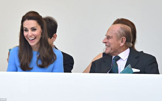 What's been said? The Duke of Edinburgh, right, has clearly tickled Kate's, left, funnybone as they converse in the Royal Box: