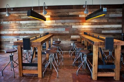 Communal tables and wood plank wall office pinterest pizza trays and everything - Restaurant communal tables ...