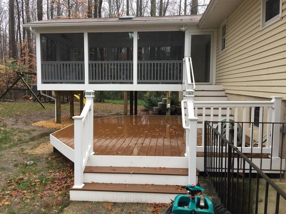 Re-screened Porch & Re-deck w/ Trex Saddle decking, White vinyl wrap around deck & porch, Washington Monument white vinyl rail