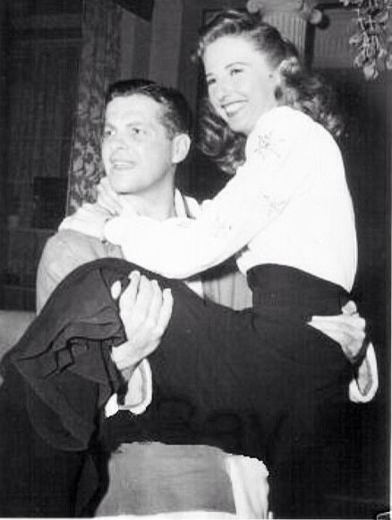 "Robert Cummings and a Barbara Stanwyck on the set of ""The Bride Wore Boots"" (1943)."