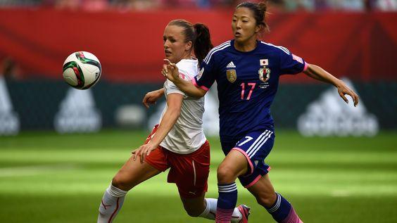Lia Waelti of Switzerland is challenged by Yuki Ogimi of Japan