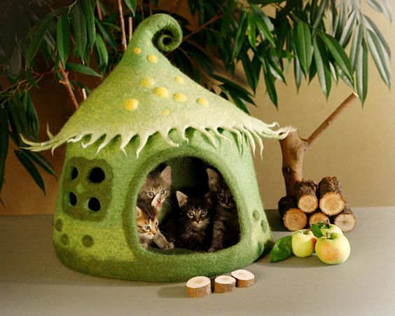 Felted cat caves like this adorable elf house are the cutest cat beds available. Cat stuff just doesn't get any spiffier than this.: