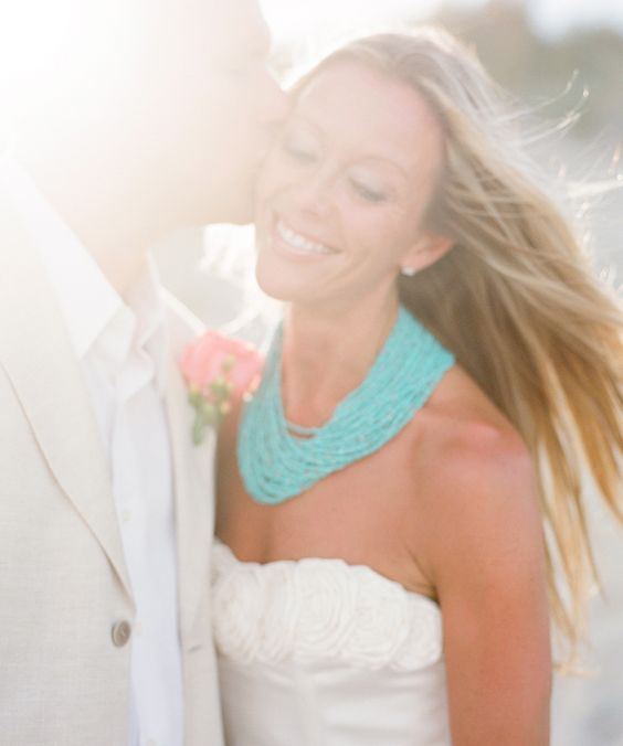 beach wedding   -Heather Payne Photography...love the bold turquoise jewelry the bride is wearing!