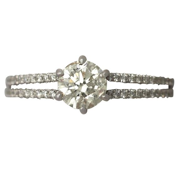 0.76Ct Diamond, 18k White Gold Solitaire Ring - Contemporary Circa 2000 | See more rare vintage Engagement Rings at https://www.1stdibs.com/jewelry/rings/engagement-rings