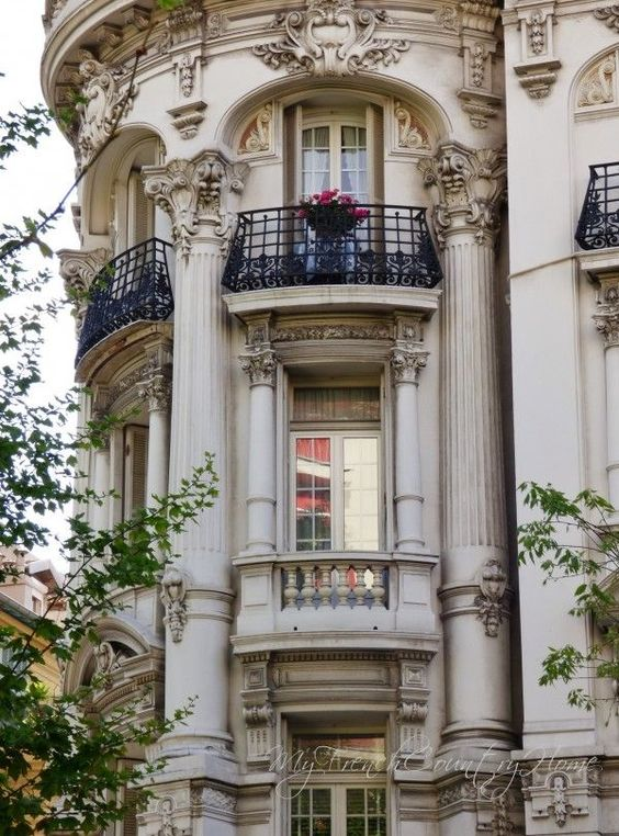 The apartment balconies are one of my favorite things about Paris.: