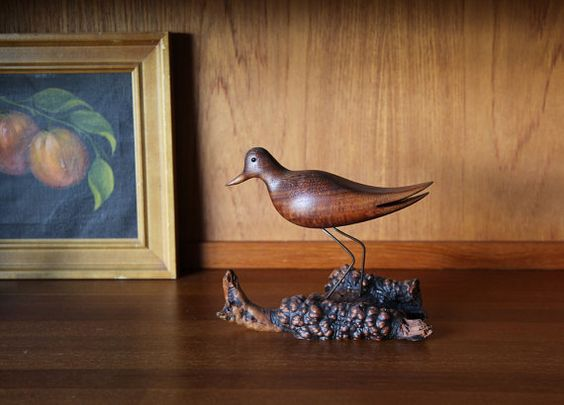 Carved wood bird and wire sculpture