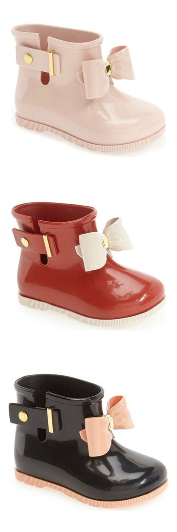 Absolutely adoring these Mini Melissa rain boots! An over-sized bow lends a playful touch to these puddle-ready boots in pink, red and black.