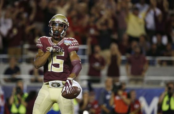 Sep 5, 2016; Orlando, FL, USA; Florida State Seminoles wide receiver Travis Rudolph (15) catches the ball and runs it in for a touchdown against the Mississippi Rebels during the first half at Camping World Stadium. Mandatory Credit: Kim Klement-USA TODAY Sports