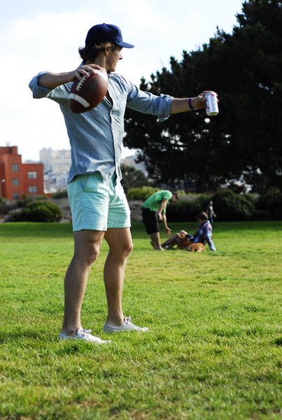 Try teaming a light blue button-down shirt with pastel green shorts for a refined yet off-duty ensemble. This outfit is complemented perfectly with white low top sneakers.   Shop this look on Lookastic: https://lookastic.com/men/looks/long-sleeve-shirt-shorts-low-top-sneakers-baseball-cap-watch/11587   — Navy Baseball Cap  — Navy Canvas Watch  — Light Blue Long Sleeve Shirt  — Mint Shorts  — White Low Top Sneakers