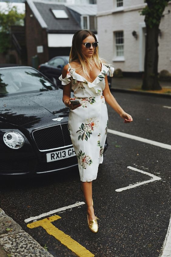 Blogger Nina Suess is putting her best foot forward in our gold loafers and Floral Midi Dress. #Topshop