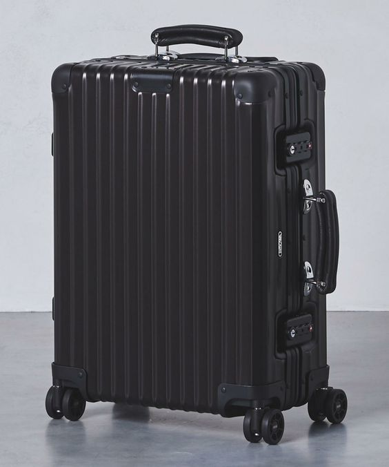 United Arrows Is Releasing Rimowa S Classic Flight Suitcases In Stealth Black Rimowa United Arrows Suitcase