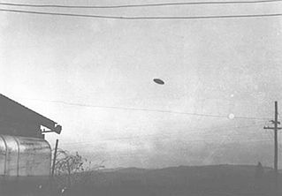 "McMinnville UFO photographs. Two farmers took pictures of a purported ""flying saucer."" These are among the best known UFO pictures, and continue to be analyzed and debated to this day. taken in McMinnville, Oregon in 1950:"