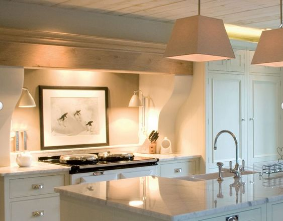 Art + sconces in cooking alcove