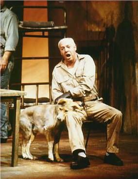 How does John Steinbeck use of dogs as a literary tool in of mice of men?