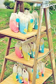 hunt and gather decor and prop rentals | gallery | eden's 2nd birthday - dip dyed muslin pouch favors filled with bubbles, fun bubble wands, bouncy balls, and snacks