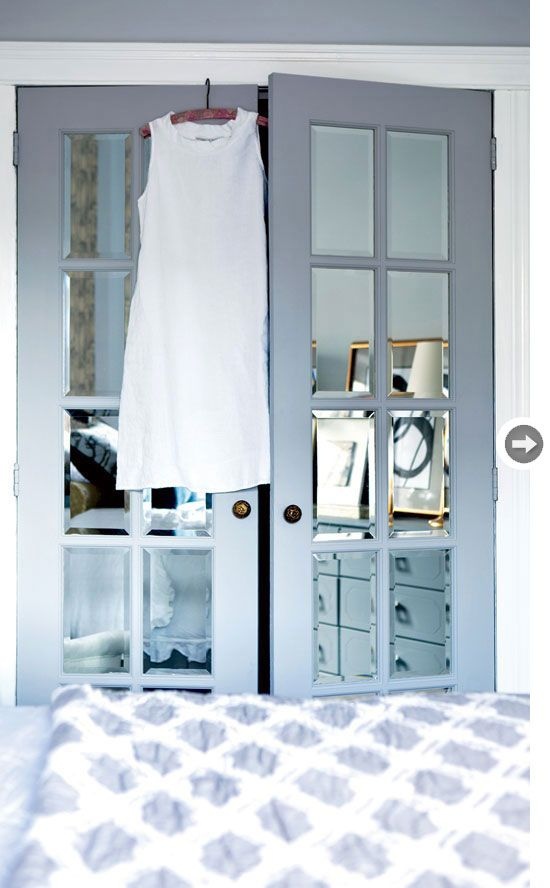 Sliding closet doors were swapped for French doors outfitted with mirrors to provide light and sparkle. - via Style at Home