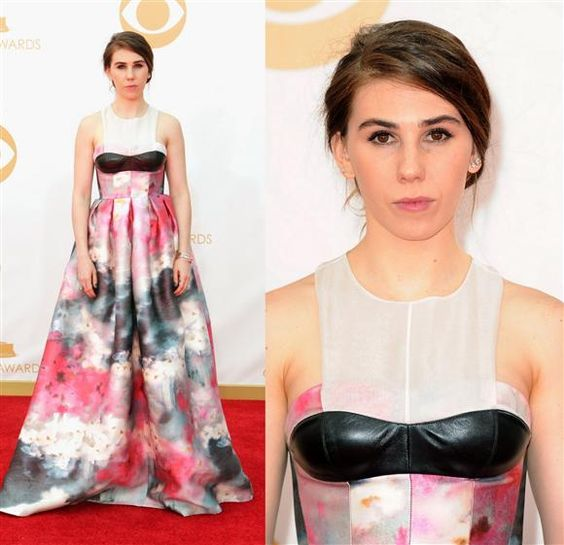 You can't be serious - put a # under her face! With Zosia Mamet, it's necessary to grade on a curve, since she gets it wrong time and time again. With that in mind, we will allow that this Honor gown shows some improvement, what with its pretty, Monet-inspired floral skirt. But her black leather breast moustache? That gets an F-minus.