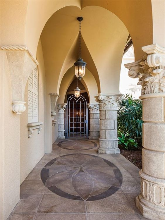 1254 Waggle Way, Naples, FL 34108   Golf estate - entry with gothic arches and ornate columns.  Lanterns and tile inlays.  The Estates at Bay Colony Golf Club.  Premier Sotheby's International Realty