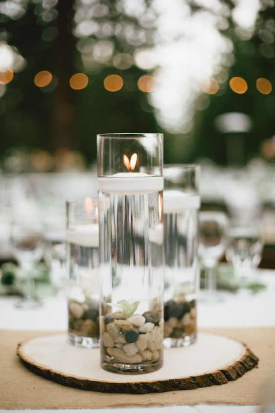 River rocks floating candles and centerpieces on pinterest
