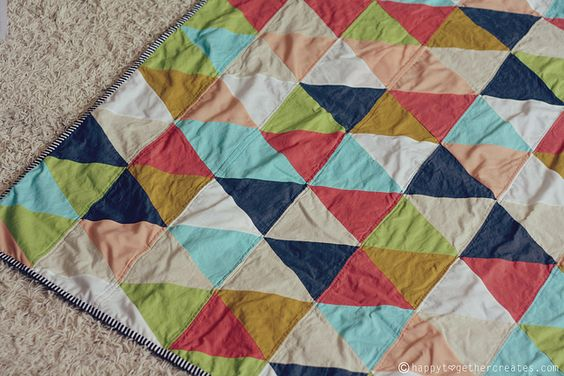 triangle quilt by @ohsohappytogether, via Flickr