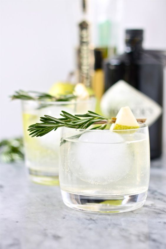 Pear Gin Cocktails 1/2 pear, cut up into small chunks 1/4 cup elderflower liqueur 1/3 cup good quality gin Ice Tonic water 2 rosemary sprigs pierced through 2 pieces of pear, for garnish