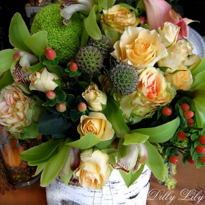 Our Roses Orchids and Berries bouquet incorporates hedge apples and scabiosa pods for an early fall flair!