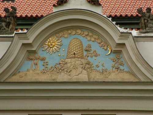 "A beehive 'house sign' on a house in Wenceslas Square, Prague, Czech Republic. [from photographer]: ""House Signs have been used since at least the Fourteenth Century to identify buildings and greatly predate house numbers."""