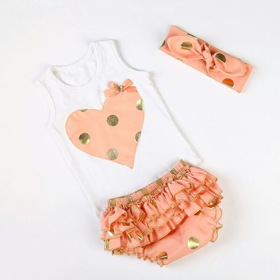 Gold Polka Dot Baby Outfit This Fabulous Gold polka dot set is So Adorable for prop pictures of any kind or just to hang-out in.... Peach/Pink/Gold polka dot!!! Top with heart, bloomers, and Head bow