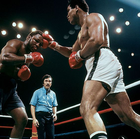 """Muhammad Ali lands a right hook to the head of Joe Frazier during their fight on Oct. 1, 1975 at Araneta Coliseum in Quezon City, Philippines. Ali won the """"Thrilla In Manila,"""" the third and final bout..."""