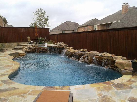 6 Freeform-pool-and-raised-spa-with-boulder-waterfalls-and ...