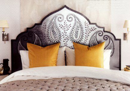 Moorish arch inspired headboard with paisley motif - perfect for Moroccan bedroom design!
