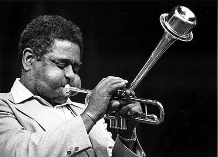 "John Birks ""Dizzy"" Gillespie was an American jazz trumpet player, bandleader, composer and occasionally, singer. ""Dizzy's contributions to jazz were huge. Bebop was known as the first modern jazz style. Swing introduced a diversity of new musicians in the bebop era like Charlie Parker, Thelonious Monk, Bud Powell, Kenny Clarke and Oscar Pettiford."