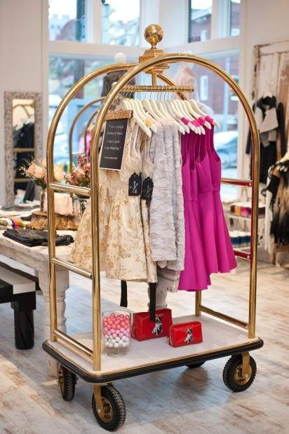 This bellman's hotel luggage cart used as a clothing rack is one of the whimsical touches to Number Fourteen Boutique in Lawrenceville.