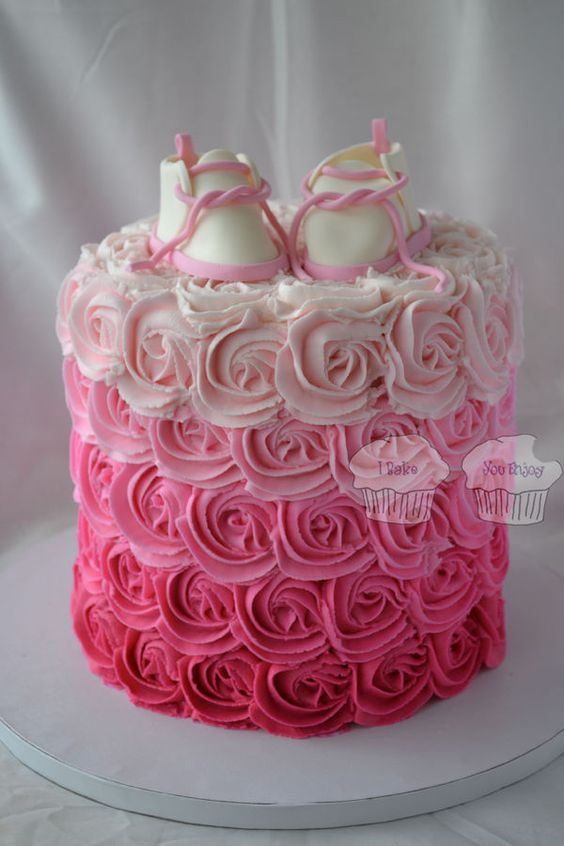 7 inch double barrel cake with buttercream rosettes