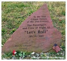 "This is a memorial stone, dedicated to the passengers and crew of flight 93.             To the first Citizens Heroes              of the 21st Century.                  ""Let's Roll"""