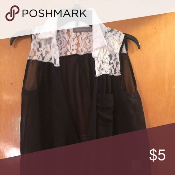 Black and white lace tank White lace collar. Black criss-cross open in front. Tops Tank Tops