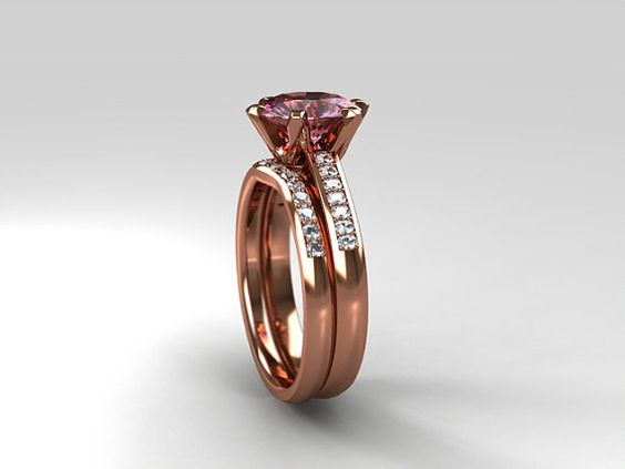 Pink tourmaline and diamond solitaire engagement ring set made from rose gold by TorkkeliJewellery
