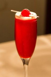 Red Velvet Cocktail    • 2oz Lindemans Raspberry Lambic • 4oz prosecco • 5 oz Chambord • 1 raspberry • Ice for mixing • Lemon peel… In a mixing glass, stir in ingredients with ice for 5 seconds. Strain into champagne flute. Squeeze lemon peel over glass and discard peel. Garnish with fresh raspberry on a pick. Drink should have a foam cap.