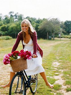 Love the white dress, and I really want a bike with a basket!